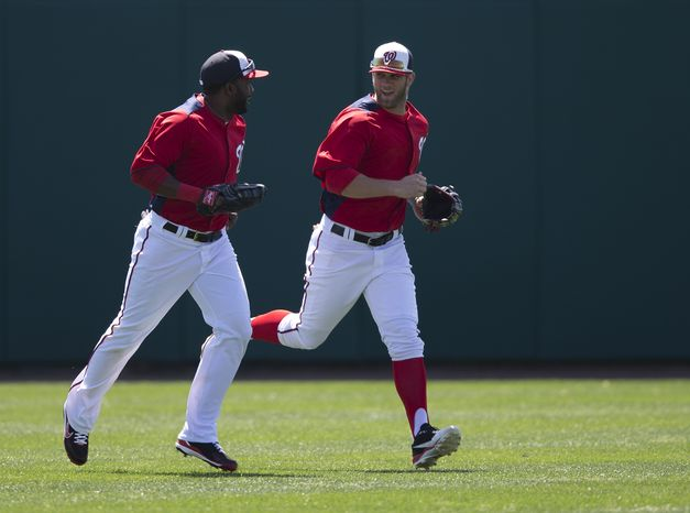 Washington Nationals outfielders Denard Span, left, and Bryce Harper run to the dugout during the fourth inning of an exhibition spring training baseball game against the Houston Astros on Thursday, March 14, 2013, in Viera, Fla. (AP Photo/Evan Vuc