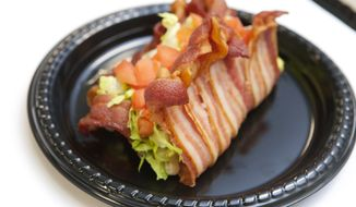 Baco, a taco in a bacon shell, won the Michigan Whitecaps minor league baseball team's fourth annual food contest. The Baco will be available at Whitecaps games this summer at Fifth Third Ballpark, in Comstock Park, Mich. (AP Photo/The Grand Rapids Press, Emily Zoldaz)
