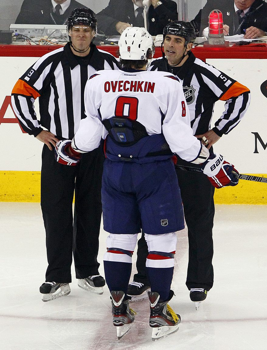 Washington Capitals' Alex Ovechkin (8), of Russia, protests a call with officials during the third period of an NHL hockey game against the Carolina Hurricanes, Thursday, March 14, 2013, in Raleigh, N.C. The Capitals won 3-2. (AP Photo/Karl B DeBlaker)