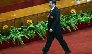 Chinese Communist Party chief and incoming President Xi Jinping walks back to his seat after cast his ballots during a plenary session of the National People's Congress held in Beijing's Great Hall of the People, China, Thursday, March 14, 2013. (AP Photo/Alexander F. Yuan)