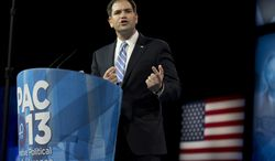 ** FILE ** Sen. Marco Rubio, Florida Republican, speaks at the 40th annual Conservative Political Action Conference in National Harbor, Md., on March 14, 2013. (Associated Press)