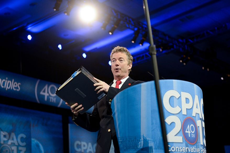 Sen. Rand Paul (R-K.Y.) holds binders which he says is the entire typed speech during his long filibuster to bring attention to the Obama administration's drone program as he takes the stage to  speak at this year's Conservative Political Action Conference (C.P.A.C.) held at the Gaylord National Hotel, National Harbor, Md., Thursday, March 14, 2013. (Andrew Harnik/The Washington Times)