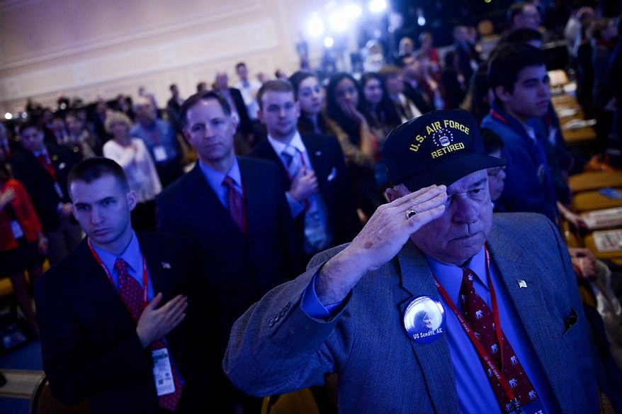 Retired Lt. Col. O.P. Ditch of Elkridge, Md., salutes during the pledge of allegiance at the start of this year's Conservative Political Action Conference (C.P.A.C.) held at the Gaylord National Hotel, National Harbor, Md., Thursday, March 14, 2013. (Andrew Harnik/The Washington Times)