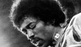**FILE** Jimi Hendrix performs in 1970 on the Isle of Wight in England. (Associated Press)