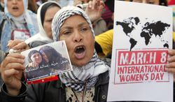 """An Egyptian woman shouts anti-Muslim Brotherhood slogans during a demonstration in Cairo on Friday, March 8, 2013, marking International Women's Day. The Arabic reads, """"Bread, freedom, social justice."""" (AP Photo/Amr Nabil)"""