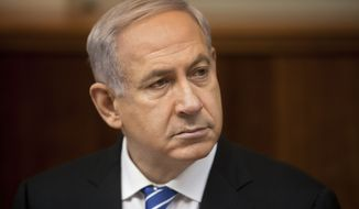Israeli Prime Minister Benjamin Netanyahu attends the weekly cabinet meeting in his Jerusalem office, Sunday, March 10, 2013. (AP Photo/Sebastian Scheiner, Pool)