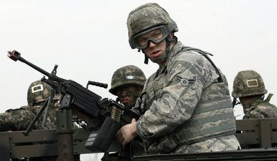 U.S. Air Force Airman First Class, Lee Simpson from Sportanburg, S.C., mans a machine gun atop a humvee, with South Korean soldiers during a joint military drill between South Korea and the United States near the Osan U.S. Air Base in Pyeongtaek, south of Seoul, South Korea, Thursday, March 14, 2013. (AP Photo/Lee Jin-man)