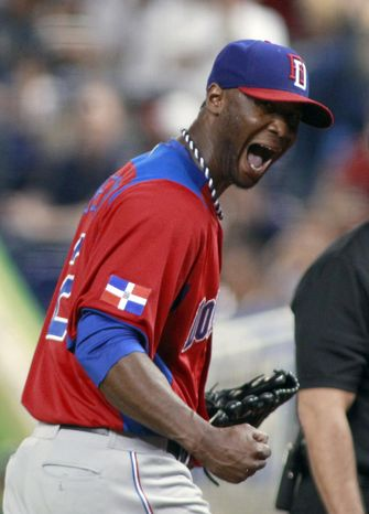 Dominican Republic pitcher Samuel Deduno reacts after striking out United States' Adam Jones to end the first inning of a second-round game of the World Baseball Classic in Miami, Thursday, March 14, 2013. (AP Photo/Joe Skipper, Pool)