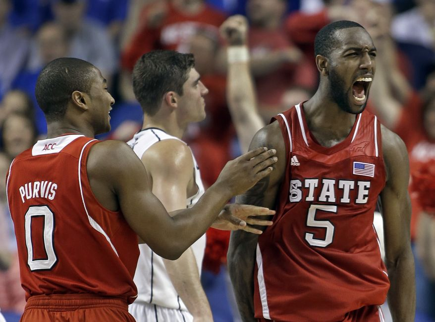 North Carolina State's C.J. Leslie (5) shouts out in celebration with teammate Rodney Purvis (0) during the second half of an NCAA college basketball game against Virginia at the Atlantic Coast Conference tournament in Greensboro, N.C., Friday, March 15, 2013. North Carolina State won 75-56. (AP Photo/Bob Leverone)