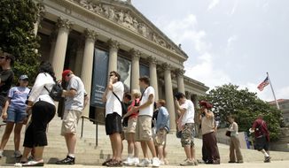 **FILE** Visitors line up outside the National Archives in Washington on July 15, 2006. (Associated Press)