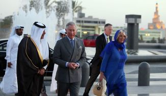 ** FILE ** Qatar's Sheikh Abdul Rahman Bin Saud Al Thani, left, escorts Prince Charles, center, and his wife Camilla during their visit to the Museum of Islamic Art in Doha, Qatar, Wednesday, March 13, 2013. (AP Photo/Osama Faisal)