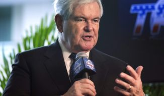 ** FILE ** Former House Speaker Newt Gingrich, R-Ga., is interviewed at the 40th annual Conservative Political Action Conference (CPAC) in National Harbor, Md., Thursday, March 14, 2013. (AP Photo/Manuel Balce Ceneta)