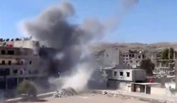 In this image taken from video obtained from the Shaam News Network, which has been authenticated based on its contents and other AP reporting, smoke rises from buildings due to heavy shelling in Maadamiyeh south of Damascus, Syria, on Thursday, March 14, 2013. (AP Photo/Shaam News Network via AP video)