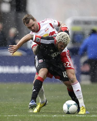 D.C. United midfielder Nick DeLeon, front, shields the ball from New York Red Bulls midfielder Jonny Steele during the first half of an MLS soccer game, Saturday, March 16, 2013, in Harrison, N.J. (AP Photo