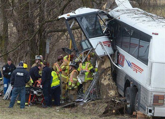 Emergency and rescue crews respond to the scene of a tour bus crash on the Pennsylvania Turnpike on Saturday, March 16, 2013 near Carlisle, Pa. (AP Photo/The Sentinel, Jason Malmont )