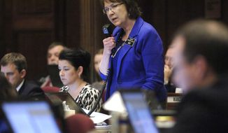 ** FILE ** North Dakota state Sen. Margaret Sitte, a Republican, speaks in favor of HB1305, one of two anti-abortion bills, during floor debate at the state Capitol in Bismarck, N.D., on Friday, March 15, 2013. (AP Photo/The Bismarck Tribune, Mike McCleary)