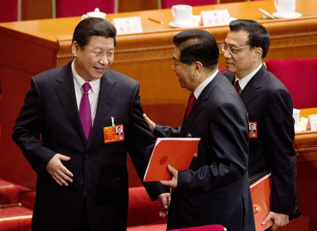 Newly installed Chinese President Xi Jinping (left) chats with Jia Qinglin (center), former chairman of the Chinese People's Political Consultative Conference, and recently appointed Premier Li Kiqiang (right) after the closing ceremony of the National People's Congress at the Great Hall of the People in Beijing on Sunday, March 17, 2013. (AP Photo/Andy Wong)