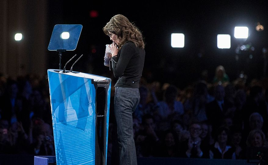 Former Alaska governor Sarah Palin takes a sip from a 7-Eleven 'super big gulp' cup while speaking during the final day of the 2013 Conservative Political Action Conference in Fort Washington, Md. on March 16, 2013. The drink was a reference to an effort in New York City to ban sodas and sugery drinks from being sold in containers larger than 16 ounces, an effort that was struck down recently by a state Supreme Court judge.(T.J. Kirkpatrick/Special to The Washington Times)