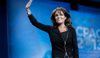 ** FILE ** Former Alaska Gov. Sarah Palin takes the stage to speak during the final day of the 2013 Conservative Political Action Conference in Fort Washington, Md., on March 16, 2013. (T.J. Kirkpatrick/Special to The Washington Times)