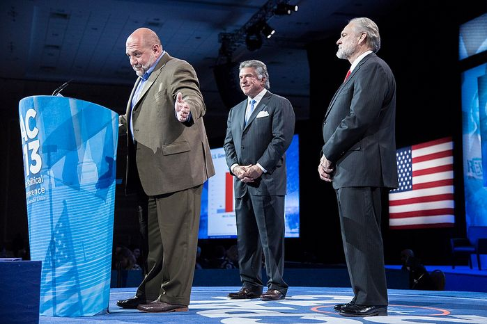 Tony Fabrizio, from left, of the Fabrizio-McLaughlin polling firm, announces the results of the Washington Times/CPAC 2013 straw poll with Al Cardenas, chairman of the American Conservative Union, and Larry Beasley, president and CEO of The Washington Times, during the final day of the 2013 Conservative Political Action Conference in Fort Washington, Md. on March 16, 2013. Sen. Rand Paul (R-KY) was the winner, narrowly edging out the close second place Sen. Marco Rubio (R-FL). (T.J. Kirkpatrick/Special to The Washington Times)