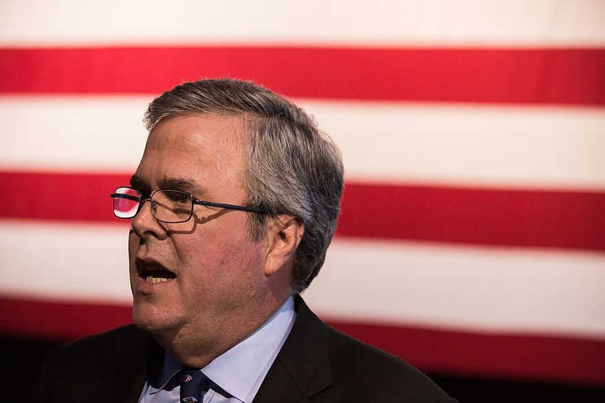 Jeb Bush (R), former Governor of Florida, poses for photos during a dinner engagement at the Conservative Political Action Conference (C.P.A.C.) held at the Gaylord National Hotel, National Harbor, Md., Friday, March 15, 2013.(Andrew S. Geraci/The Washington Times)