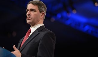 ** FILE ** Virginia Attorney General Ken Cuccinelli is the first speaker at this year's Conservative Political Action Conference (C.P.A.C.) held at the Gaylord National Hotel, National Harbor, Md., Thursday, March 14, 2013. (Andrew Harnik/The Washington Times)