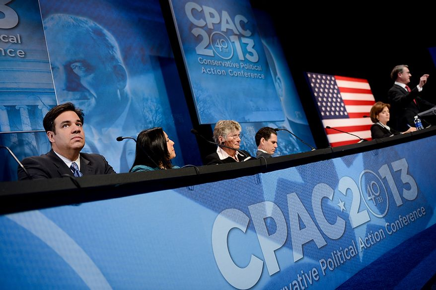 Rep. RaË™l Labrador (R-Idaho), left, speaks on an immigration panel at this year's Conservative Political Action Conference (C.P.A.C.) held at the Gaylord National Hotel, National Harbor, Md., Thursday, March 14, 2013. (Andrew Harnik/The Washington Times)