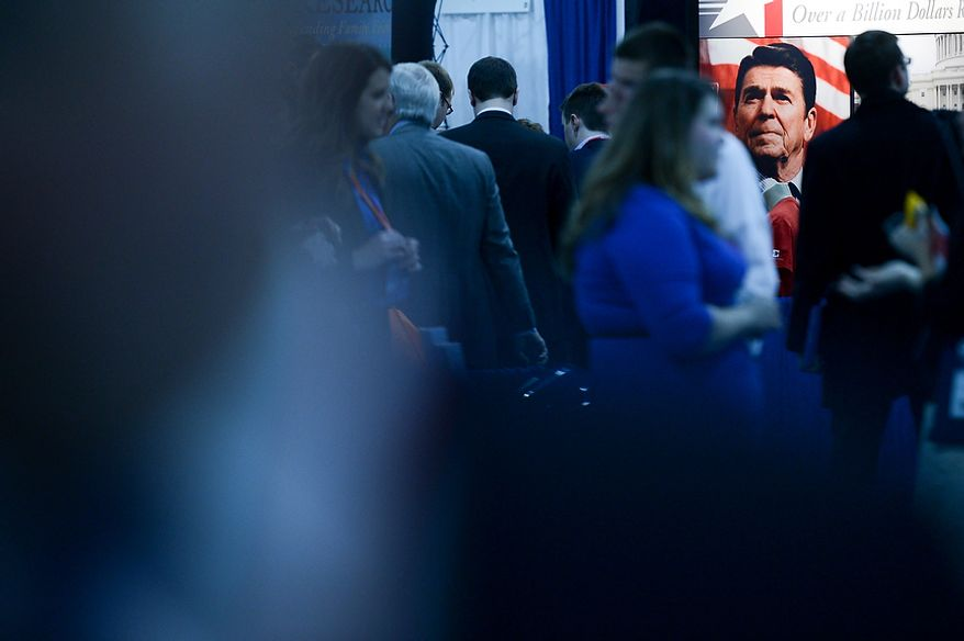 Visitors make their way though a downstairs exhibition hall at this year's Conservative Political Action Conference (C.P.A.C.) held at the Gaylord National Hotel, National Harbor, Md., Thursday, March 14, 2013. (Andrew Harnik/The Washington Times)