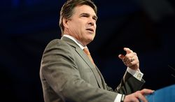** FILE ** Texas Gov. Rick Perry speaks at the Conservative Political Action Conference at the Gaylord National Hotel in National Harbor, Md., on Thursday, March 14, 2013. (Andrew Harnik/The Washington Times)