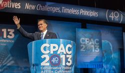 ** FILE ** Mitt Romney (R) waves to the audience before he speaks at this year's Conservative Political Action Conference (C.P.A.C.) held at the Gaylord National Hotel, National Harbor, Md., Friday, March 15, 2013. (Andrew S. Geraci/The Washington Times)
