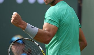 Rafael Nadal, of Spain, reacts after winning a game against Juan Martin del Potro, of Argentina, during their match at the BNP Paribas Open tennis tournament, Sunday, March 17, 2013, in Indian Wells, Calif. (AP Photo/Mark J. Terrill)