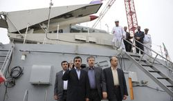 ** FILE ** Then-Iranian President Mahmoud Ahmadinejad (second from left) waves during the inauguration of the Jamaran-2 guided missile destroyer in the port city of Anzali, Iran, about 150 miles northwest of Tehran, the capital, on Sunday, March 17, 2013. Iran launched the domestically built ship in the Caspian Sea in the nation's first deployment of a major warship in the oil-rich region. (AP Photo/ISNA, Hemmat Khahi)