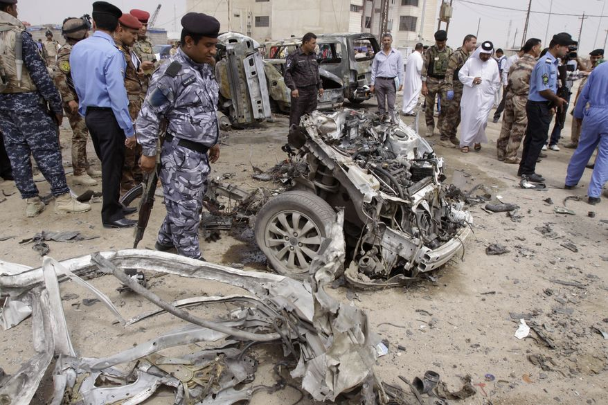 Iraqi security forces inspect the site of a car bomb attack in Basra, Iraq, on Sunday, March 17, 2013. The blast was one of two to hit the oil-rich southern city within minutes of each other. (AP Photo/Nabil al-Jurani)