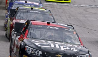 Kasey Kahne (5) leads the field during the NASCAR Sprint Cup Series Food City 500 auto race on Sunday, March 17, 2013, in Bristol, Tenn. (AP Photo/Wade Payne)