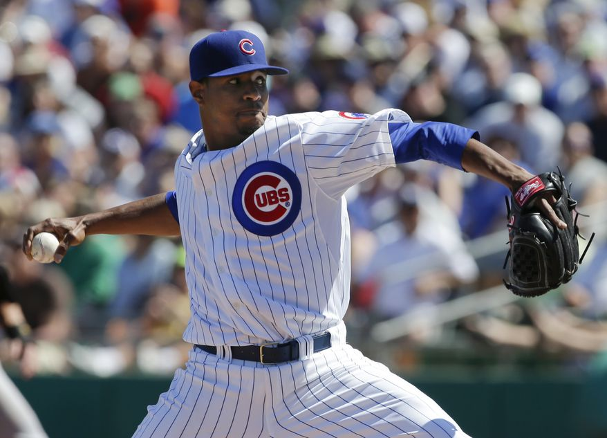 Chicago Cubs starting pitcher Edwin Jackson throws to the Colorado Rockies during the first inning of a spring training baseball game in Mesa, Ariz., Wednesday, March 13, 2013. (AP Photo/Chris Carlson)