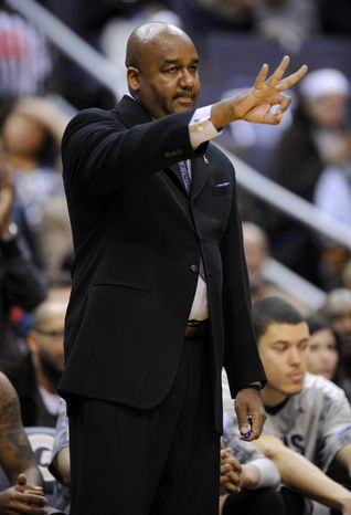 Georgetown head coach John Thompson III gestures during the first half of an NCAA college basketball game against Syra
