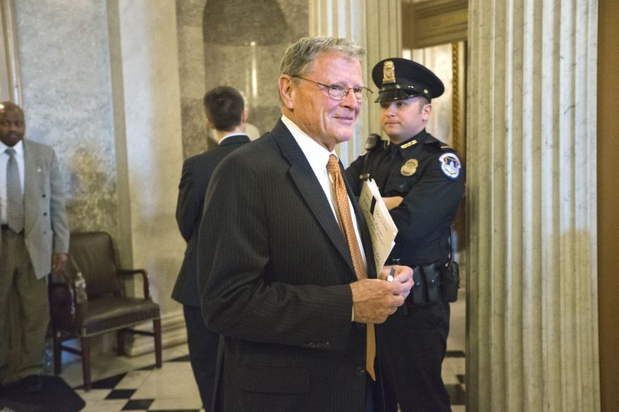 **FILE** Sen. James Inhofe of Oklahoma, the top Republican on the Senate Armed Services Committee, leaves the Senate chamber at the Capitol in Washington on Feb. 14, 2013. (Associated Press)