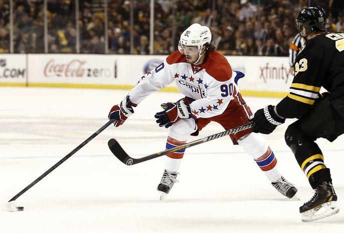 Washington Capitals' Marcus Johansson during the first period of a NHL hockey game against the Boston Bruins in Boston Saturday, March 16, 2013. (AP Photo/Winslow Townson)