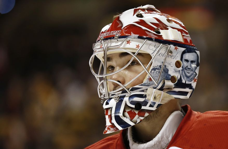 Washington Capitals goalie Michal Neuvirth during the third period of a NHL hockey game against the Boston Bruins in Boston Saturday, March 16, 2013. (AP Photo/Winslow Townson)