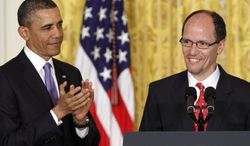 **FILE** President Obama applauds in the East Room of the White House in Washington on March 18, 2013, during his announcement that he would nominate Thomas E. Perez (right) for Labor secretary. (Associated Press)