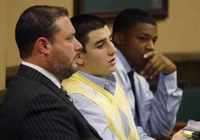 ** FILE ** From left, Defense attorney Adam Nemann, his client, defendant Trent Mays, 17, and co-defendant 16-year-old Ma'lik Richmond listen to testimony during Mays and Richmond's trial in juvenile court on Thursday, March 14, 2013, in Steubenville, Ohio. (AP Photo/Keith Srakocic, Pool)