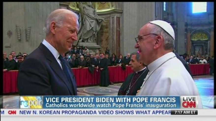 Vice President Joseph R. Biden greets Pope Francis during the Catholic pontiffs installation mass in Vatican City. (Screen shot: CNN)