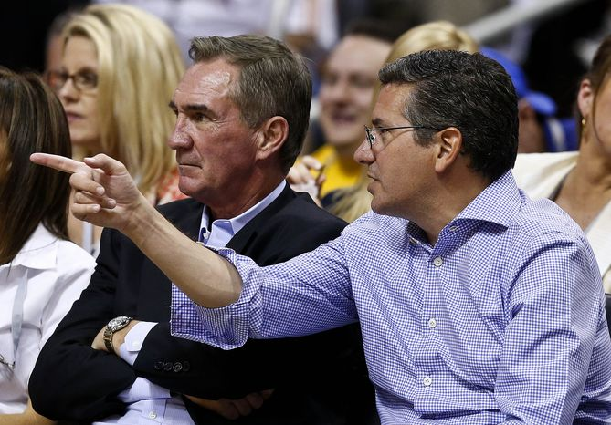 Washington Redskins owner Dan Snyder, right, watches a Phoenix Suns versus Los Angeles Lakers matchup with Redskins head coach Mike Shanahan in the second half of an NBA basketball game on Monday, March 18, 2013, in Phoenix. The Suns defea