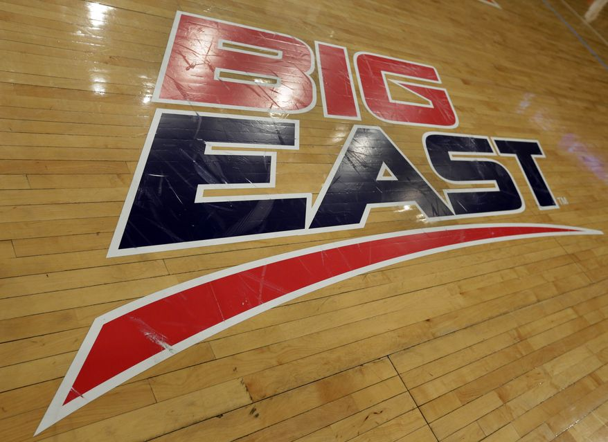 **FILE** A Big East logo is displayed on the court at Madison Square Garden before an NCAA college basketball game between Marquette and St. John's, Saturday, March 9, 2013, in New York. The conference has reached an agreement with seven departing basketball members that will allow them to separate from the football schools and create their own conference on July 1. Commissioner Mike Aresco told The Associated Press on Friday the seven Catholic schools that are leaving to form a basketball-centric conference will get the Big East name, along with the opportunity to play their league tournament in Madison Square Garden.(AP Photo/Richard Drew)