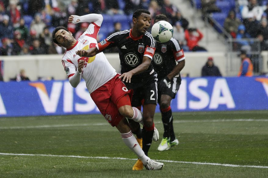 D.C. United defenderJames Riley, right, defends against New York Red Bulls forward Fabian Espindola during the first half of an MLS soccer game, Saturday, March 16, 2013, in Harrison, N.J. (AP Photo/Julio Cortez)