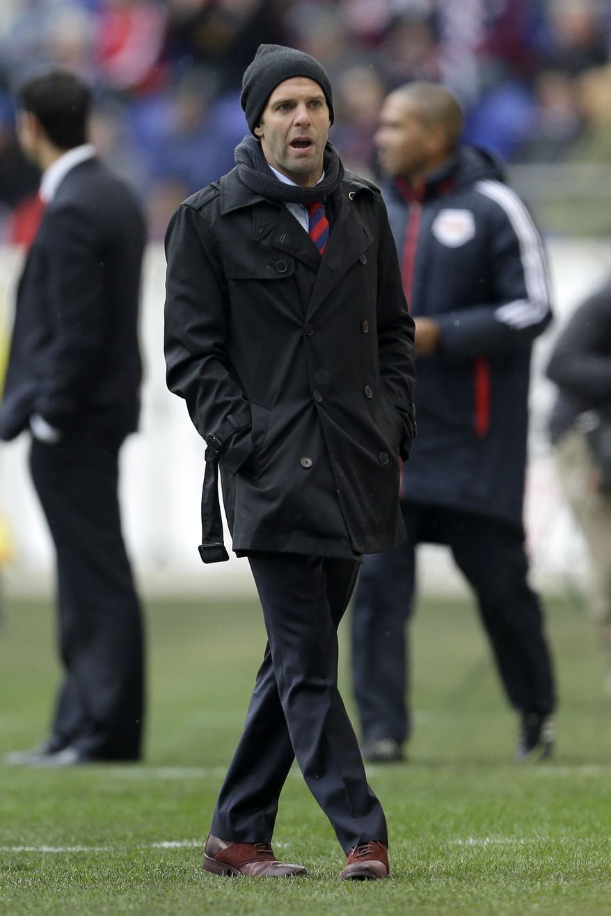 D.C. United head coach Ben Olsen looks on during the second half of an MLS soccer game against the New York Red Bulls, Saturday, March 16, 2013, in Harrison, N.J. The teams tied 0-0. (AP Photo/Julio Cortez)