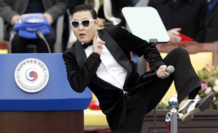 """South Korean rapper PSY performing last month before presidential inauguration ceremony at the National Assembly in Seoul, South Korea. PSY said Monday on a Twitter-like South Korean website that he will change the title of his potential """"Gangnam Style"""" follow-up over worries it could offend Arabs. (AP Photo/Lee Jin-man, File)"""