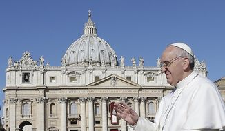Pope Francis waves to crowds as he arrives for his inauguration Mass in St. Peter's Square at the Vatican on Tuesday, March 19, 2013. (Associated Press)