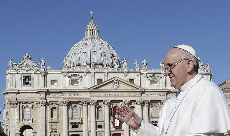Pope Francis waves to crowds as he arrives for his inauguration Mass in St. Peter's Square at the Vatican on Tuesday, March 19, 2013. (Associated Pres