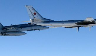 This undated photo provided by the U.S. Air Force shows a Canadian Air Force F-18 Hornet jet (left) escorting a Russian TU-95 Bear heavy bomber out of Canadian airspace. Japanese interceptor jets were scrambled to intercept two TU-95s recently. (Associated Press)